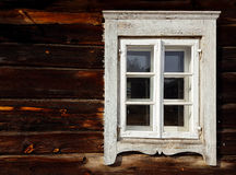 Old window. In a dark wooden wall Royalty Free Stock Photo
