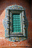 Old window decorated by colorful tails. Stock Photo