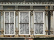 Old window, decorated with stylized columns Stock Photography