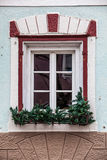 Old window with decorations and potted plants Royalty Free Stock Photos