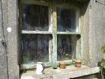 Old window. The window in a derelict farm house Stock Image
