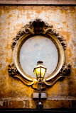 Old window detail. Detailed old window frame with vintage public light Royalty Free Stock Photo