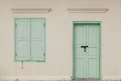 Old window and door on color wall thai style, vintage tone class Royalty Free Stock Photo