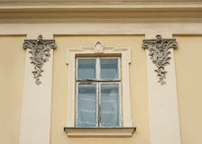 Old window with elements of modeling in the city of Lvivv Stock Photo