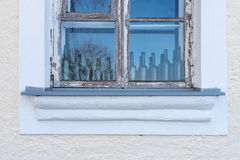 Old window with empty bottles royalty free stock images
