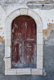 An old window facing the harbour on the Greek island of Kastellorizo. Royalty Free Stock Images