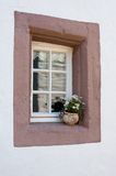 Old window with flowerpot. Old wall with a window with nice flower in pot Royalty Free Stock Photos
