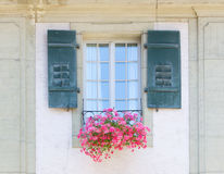 Old window and flowers at a historic building Royalty Free Stock Photo