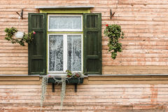 Old window. With flowers in Riga Stock Photo