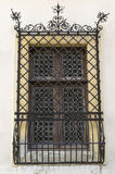 Old window with forged grid Stock Photo