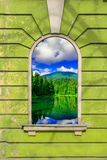 Old window frame with picture. Old window frame on the wall with picture of mountain lake Stock Photos