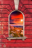 Old window frame with picture. Old window frame on the wall with picture of stones on sunset Royalty Free Stock Photo