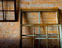 Old window frames on a brick wall. Shot in an old abandoned building Fort McLeod Alberta Stock Photography