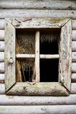Old window without glass. Concept of abandonment, despair, loneliness and desolation. Old window without glass in a wooden house. Concept of abandonment, despair royalty free stock photos