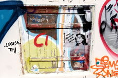 Old window with graffiti in Athens, Greece Stock Photo