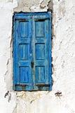 Old window in a Greek island Stock Photos