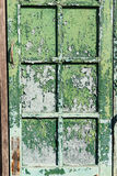 The old window with green closed shutters on an old house. Vinta. Ge background, texture. show scratched of old color Royalty Free Stock Images