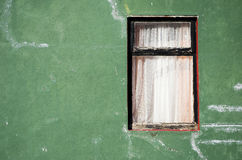 Old window. On a green wall Royalty Free Stock Photography