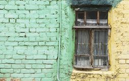 Old window and green wall with space for text Stock Images