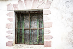 Old window with green wood. And retro mosquetera and rusty iron hardware and Stock Image