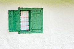 Old Window with Green Wooden Shutters Royalty Free Stock Image