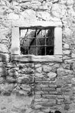 Old window grille of a ruined castle Stock Image