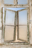Old window. Grungy background with an old wooden vintage window and dirty window glass in the desert Stock Photos
