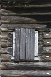 Old window hammered wooden planks of a wooden house, an abandoned farmhouse Russia. Disruption in the village, the abandoned settl Stock Image