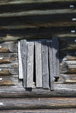 Old window hammered wooden planks of a wooden house, an abandoned farmhouse Russia. Disruption in the village, the abandoned settl. Ements Royalty Free Stock Images