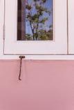 Old window hook, Chino-Portuguese style Stock Photo