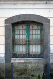 Old window with iron bars Royalty Free Stock Photography