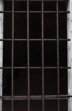 Old window with iron bars. Window with iron bars for protection of an old building Stock Photo