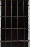 Old window with iron bars Stock Photo