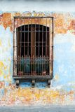 Spanish Colonial Architecture, Window, Guatemala. Old window with an iron grate and bars in Guatemala. Old Spanish colonial architecture with texture and patina stock images