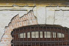 Old window with iron grid. At home deteriorated by abandonment Royalty Free Stock Image