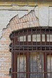Old window with iron grid. At home deteriorated by abandonment Stock Photos