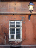 Old window and lantern. Window on old haus with public gas lantern Royalty Free Stock Image