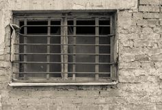 Old window with lattice on brick wall of beige tone Stock Photo
