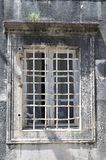 Old window with lattice in vintage wall Stock Images