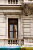 old window little terrace colors and head of lion Royalty Free Stock Images