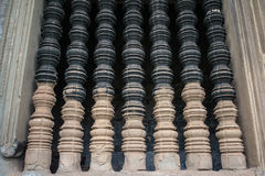 The old window made by stone in ancient Khmer art. Royalty Free Stock Photo