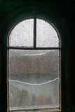 Old window of medieval castle with wooden frame, broken glass Stock Photo