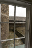 Old window of medieval castle with wooden frame Stock Image