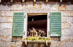 Old Window on the Mediterranean house. Old window on a typical century-old house somewhere in the sea ... It works very tranquil and romantic Royalty Free Stock Images