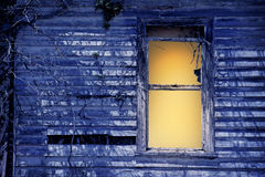 Old window by moonlight stock image