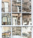 Old window with non-uniform reflections in glass. Old window with non uniform reflections in glass Royalty Free Stock Images