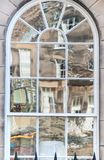 Old window with non-uniform reflections in glass. Old window with non uniform reflections in glass Royalty Free Stock Photography