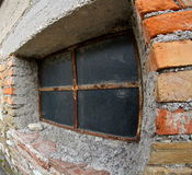 Old window in a old brick wall Stock Photos