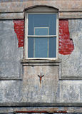 Old Window in Old Building. Old building with window and red brick Stock Images
