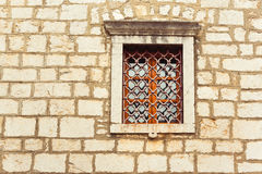 Old window on old wall. Fortified church stock images